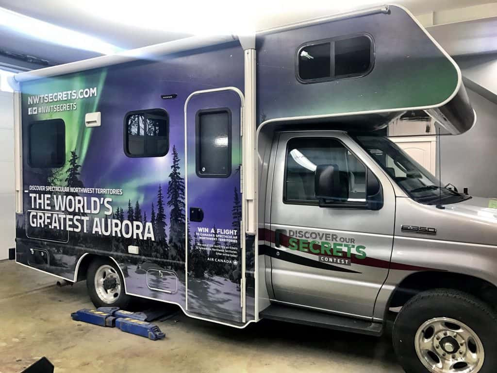 The World's Greatest Aurora partial vehicle wrap