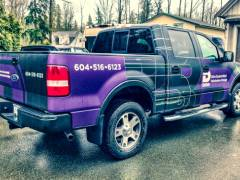black and purple work truck wrap
