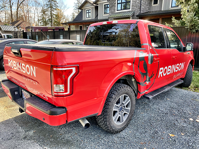 red vinyl truck wrap for robinson supply